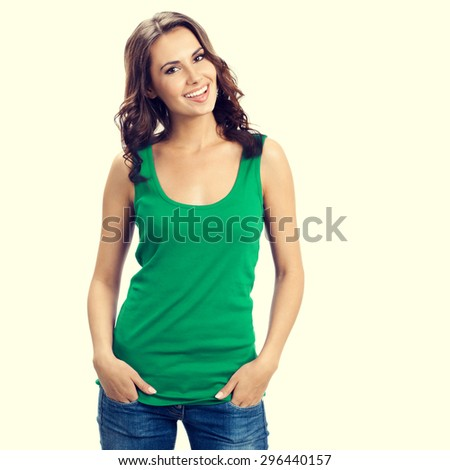 Portrait of young happy smiling brunette woman in smart green casual clothing - stock photo
