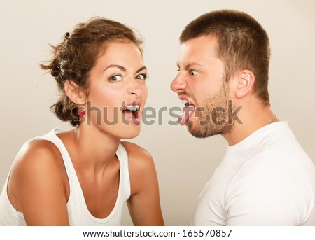 Portrait of young happy smiling couple, isolated on white background - stock photo