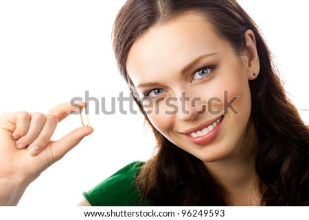 Portrait of young happy smiling woman showing Omega 3 fish oil capsule, isolated over white background - stock photo