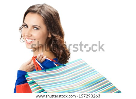 Portrait of young happy smiling woman with shopping bags, isolated over white background - stock photo