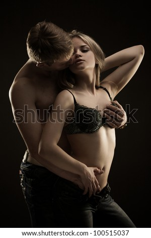 Portrait of young heterosexual couple loving each over with passion - stock photo