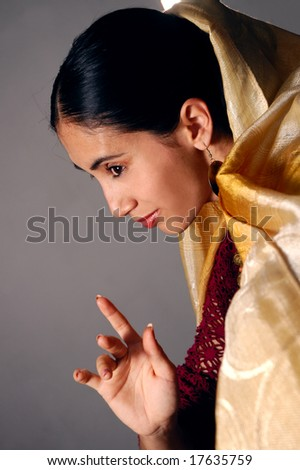 Portrait of young indian beauty in traditional clothes - stock photo