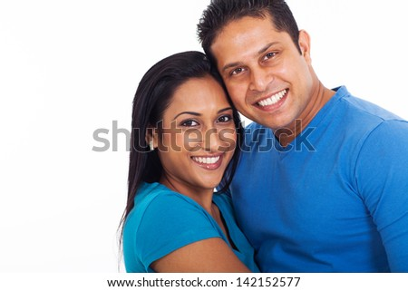 portrait of young indian couple over white background - stock photo