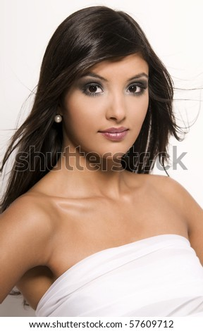 Portrait of young indian woman on white background. - stock photo