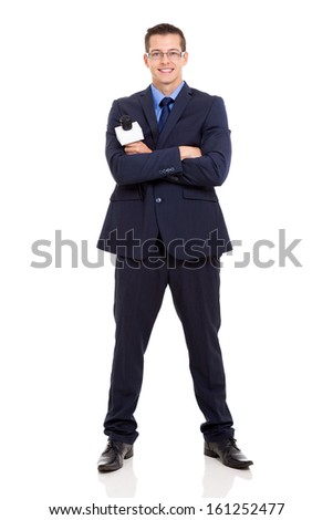 portrait of young journalist with arms crossed on white background - stock photo