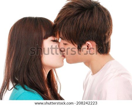 portrait of young kissing couple - stock photo