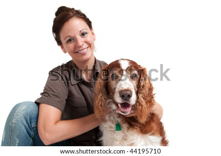 portrait of young lady with her dog, isolated over white, focus on the dog - stock photo