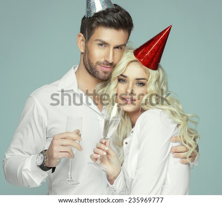 Portrait of young lovers celebrating  - stock photo