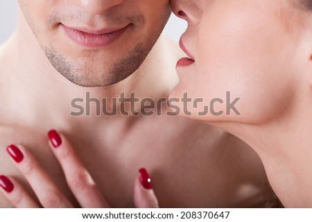 Portrait of young lovers having intimate moment - stock photo