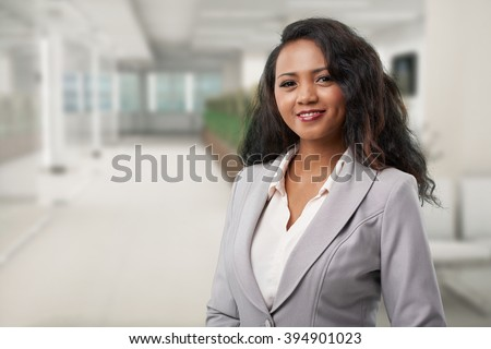 Portrait of young Malagasy business lady  smiling and looking at camera - stock photo