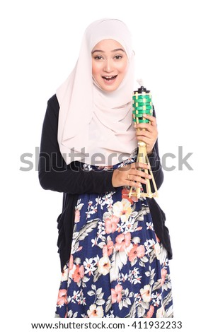 portrait of young malay woman in full shot posing with her dress while holding oil lamp or pelita isolated in white - stock photo