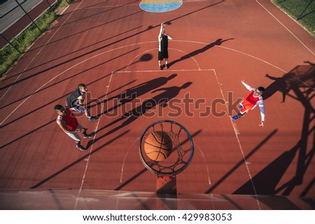 Portrait of young male basketball player in free throw pose. - stock photo
