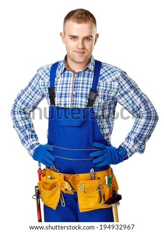 Portrait of young male construction worker with tool belt isolated on white background - stock photo