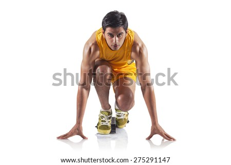Portrait of young male runner at starting block isolated over white background - stock photo