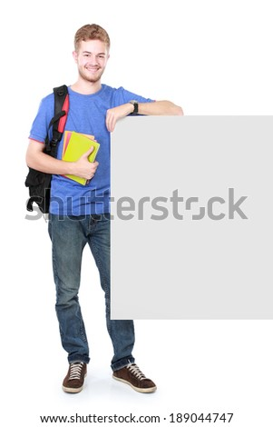 portrait of young male student holding white blank board - stock photo
