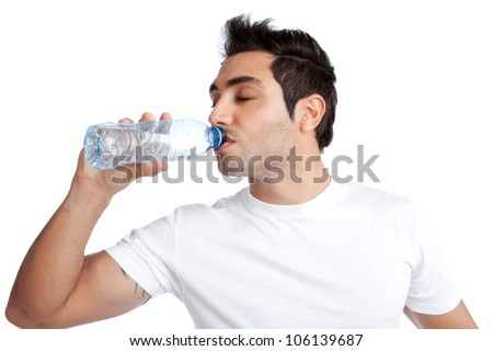 Portrait of young man drinking water from bottle isolated on white background. - stock photo