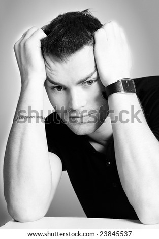 Portrait of Young man having problems - stock photo