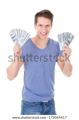 Portrait Of Young Man Holding Banknotes Over White Background - stock photo