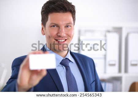 Portrait of young man holding blank white card. - stock photo