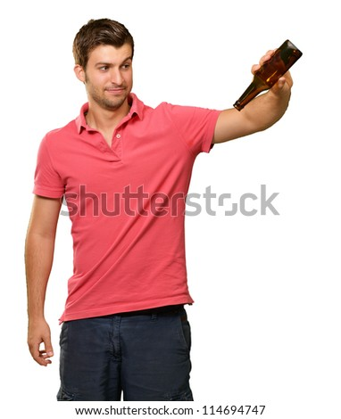 Portrait Of Young Man Holding Empty Bottle On White Background - stock photo