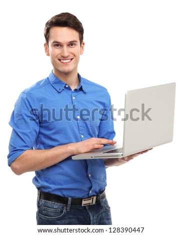 Portrait of young man holding laptop - stock photo
