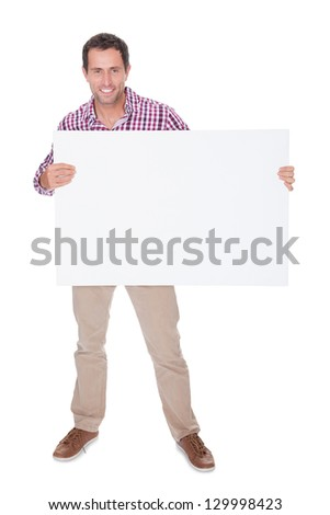 Portrait Of Young Man Holding Placard Isolated On White Background - stock photo