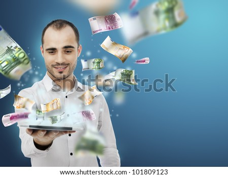 Portrait of young man holding the tablet pc and Money Coming out of Touch screen. Concept of business growth and e-trade - stock photo
