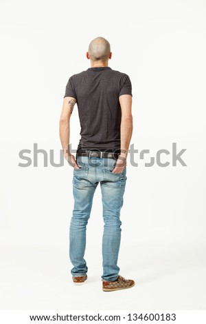 portrait of  young man in studio, back view - stock photo