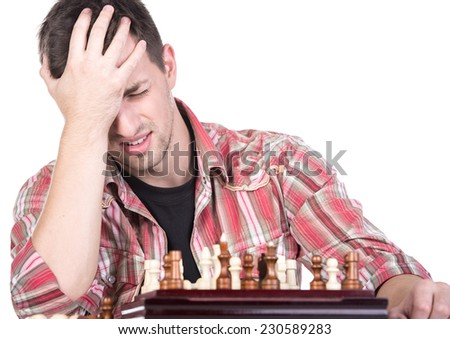 Portrait of young man is playing chess covered her face. He lost. - stock photo