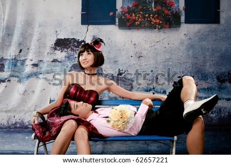 Portrait of young man lie his head on girl knee - stock photo