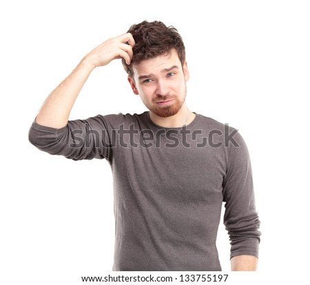 Portrait of Young Man Looking Perplexed - stock photo