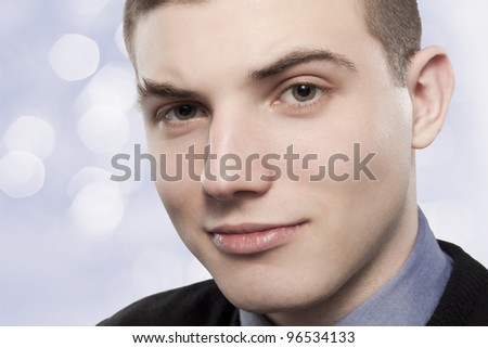 Portrait of young man on blue background - stock photo