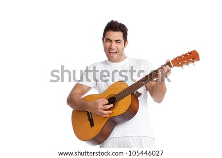 Portrait of young man playing guitar isolated on white background. - stock photo