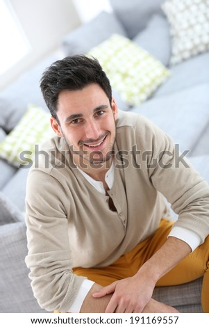 Portrait of young man relaxing at home - stock photo