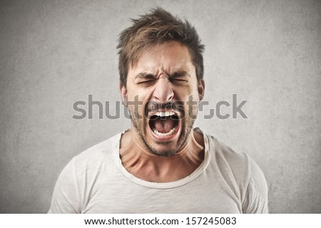 portrait of young man screaming - stock photo