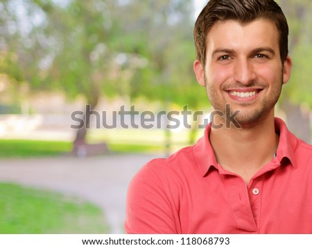 Portrait of young man smiling, outdoor - stock photo