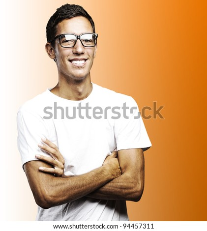 portrait of young man smiling with glasses against a purple background - stock photo