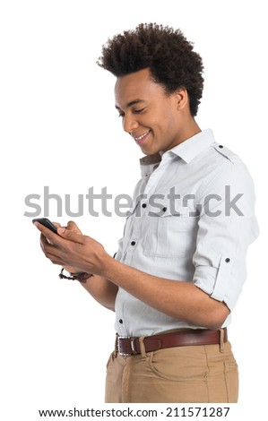 Portrait Of Young Man Texting With Smartphone Isolated On White Background - stock photo