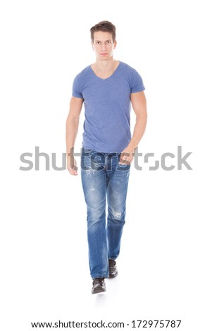 Portrait Of Young Man Walking Over White Background - stock photo