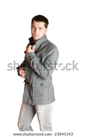 Portrait of Young man wearing coat isolated on white - stock photo