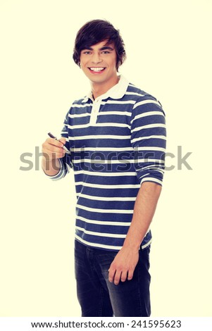 Portrait of young man with a pen. - stock photo