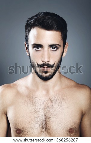 Portrait of young man with beard and mustache - stock photo