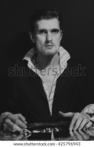 Portrait of young man with cocaine addict - stock photo