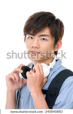 portrait of young man with earphones - stock photo