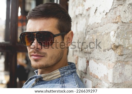 Portrait Of Young Man With Glasses And Beard - stock photo