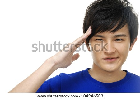 Portrait of young man with hand ever the eyes and looking up - stock photo