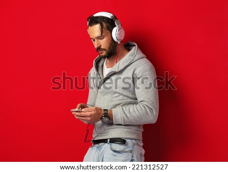 Portrait of young man with headphones - stock photo