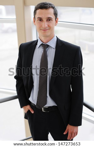 Portrait of young manager in black jacket - stock photo