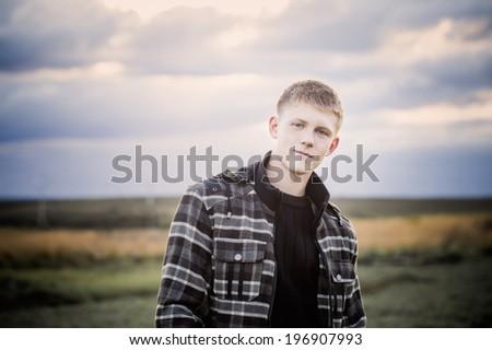 portrait of young men outdoor - stock photo