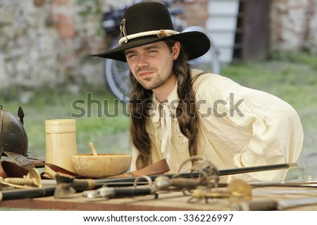 Portrait of young musketeer with hat. 9th July 2011, CESKY RUDOLEC. CZECH REPUBLIC. - stock photo